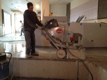 grinding the concrete floors